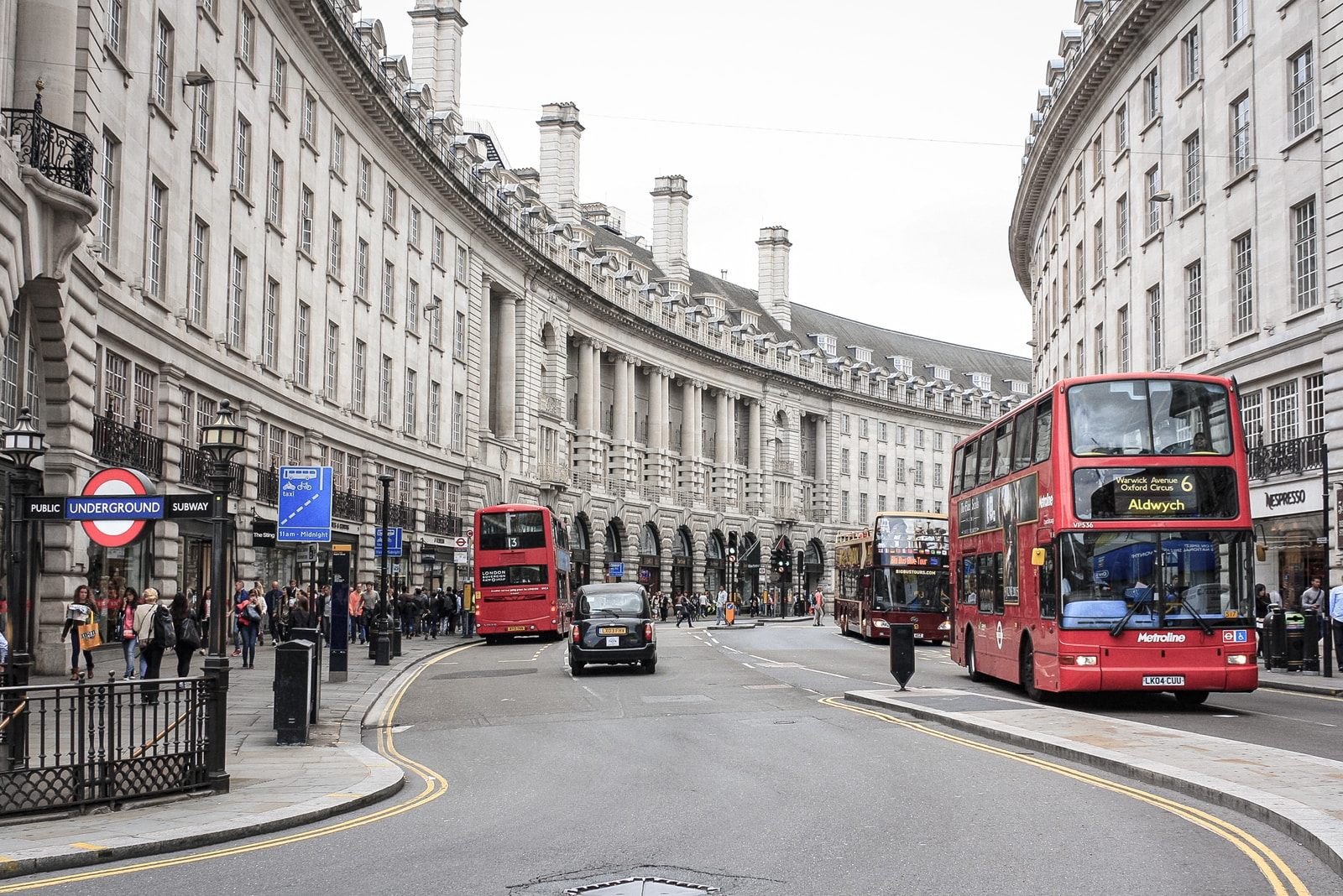 red double decker bus on road near building during daytime